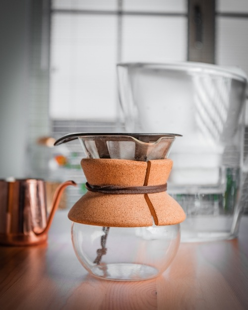 The Chemex coffeemaker is a type of pour-over system which comprises of an hourglass shaped vessel and a specially designed filter. -